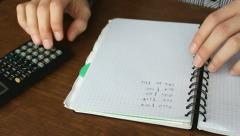 Man calculates home expenses with a calculator, managing home budget Stock Footage