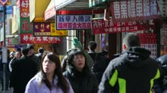 Chinatown sidewalk people walking - stock footage
