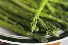 A plate of asparagus - stock photo