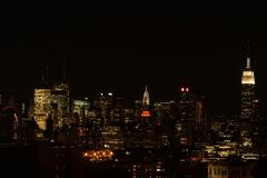 New York City skyline NIGHT Empire State Building Hotel New Yorker Metlife Stock Photos