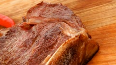 Savory : roasted beef spare rib on wooden plate with cutlery Stock Footage