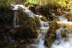 rapids in jiuzhaigou valley - stock photo
