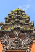 repeated balinese sculptures vertical - stock photo
