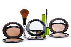 Various cosmetics isolated over white. makeup products Stock Photos