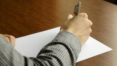 Businessman writing with a pen in the office Stock Footage