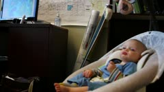 a mother works with her baby by her side at the office - stock footage