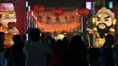 Crowd walk on China night street market,cartoon characters. Stock Footage