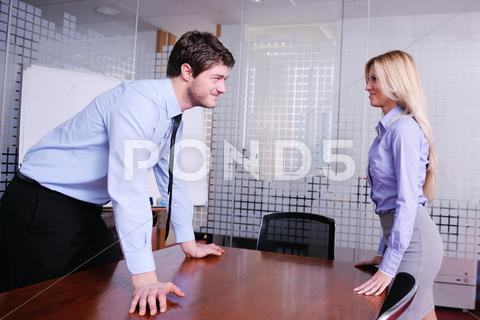 Stock photo of angry busines sman screaming at employee