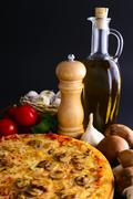 traditional pizza and ingredients - stock photo