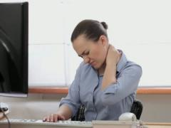 Young businesswoman in pain holding her neck  NTSC - stock footage