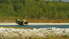 Armored car dives into the water very fast.Russian army training Stock Footage
