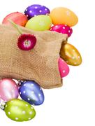 pile of easter eggs in pouch - stock photo