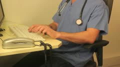 Doctor on computer Stock Footage