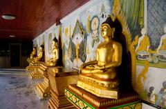 golden buddha statue in buddha temple - stock photo