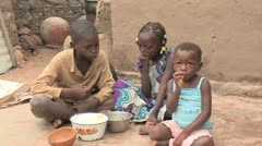 Burkina Faso: Children Eating Simple Meal in Africa Stock Footage