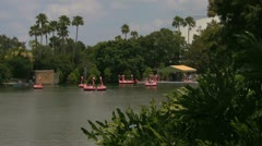 Pink Flamingo Paddle Boats on a Lake at Seaworld Orlando Stock Footage