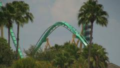Kraken Rollercoaster Going Down First Drop with Corkscrew Stock Footage