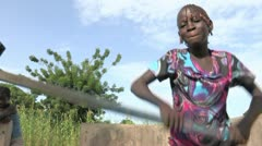 Burkina Faso: Girl at the Water Pump Stock Footage