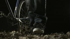 Pushing bike on dried leaves, Slow Motion Stock Footage