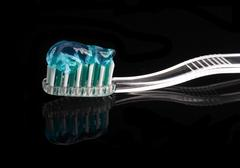 toothbrush and paste - stock photo