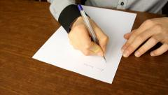 Human  writing a formal letter in his office Stock Footage