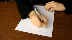 Man writing a formal letter to the president close up, white sheet of paper Stock Footage