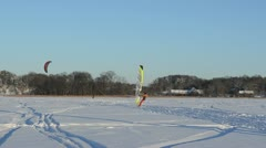 Panorama people ice sail surf  kiteboard frozen lake  winter Stock Footage