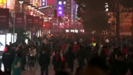 Busy Night Crowds Traffic on Nanjing Road Slow Motion Stock Footage