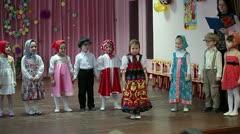 Children telling verses on the stage in kindergarten Stock Footage