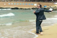 Happy businessman dancing on the beach, slow motion shot at 120fps Stock Footage