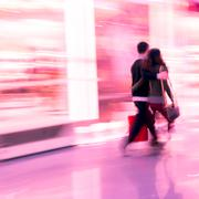 Shopping lover man and woman walk in marketplace Stock Photos