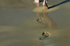 Footprints on the beach left behind, , slow motion shot at 480fps Stock Footage