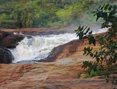 raging torrent at murchison falls - stock photo