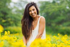woman in field of flowers - stock photo