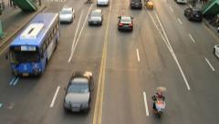 Tilt up shot of cars on road Stock Footage