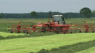 Stock Video Footage of Farmer haying  grassland