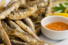 fried fresh sprat fish with souce. good seafood.; - stock photo