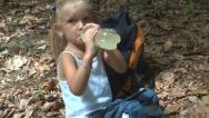 Child Drinking Juice and Resting after Hiking in Mountains, Tourists, Children Stock Footage