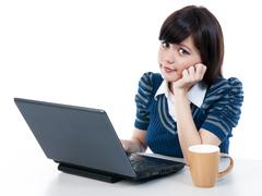 Stock Photo of cute young asian woman using laptop