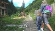Tourists Hiking in Mountains, Mother and Child Climbing, People Walking on Path Stock Footage