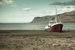 Abandoned fishing ship in iceland Stock Photos