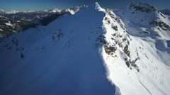 Flying over snow covered mountain peak Stock Footage