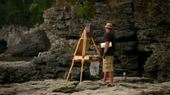 ARTIST PAINTING ON WATERFRONT, DOOR COUNTY, WISCONSIN, LAKE MICHIGAN Stock Footage