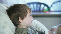 Sick little boy using nebulizer to inhale medicine - stock footage