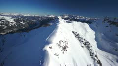 Aerial mountain crest and panorama in winter Stock Footage