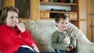 Stock Video Footage of Mother and little boy watching TV
