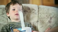 Stock Video Footage of Little boy using nebulizer to inhale medicine, close up