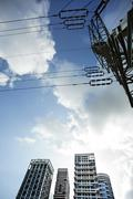 Apartment buildings & electricity pylon Stock Photos