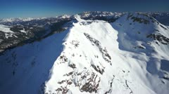 Stock Video Footage of aerial snow covered mountain panorama