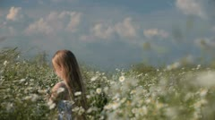 Child picking flowers on spring meadow Stock Footage